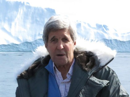 US Secretary of State John Kerry (R) Danish Minister for Foreign Affairs Kristian Jensen (L) and Greenland Premier Kim Kielsen pose during a tour to the Jakobshavn Glacier and the Ilulissat Icefjord, located 155 miles (250 km) north of the Arctic Circle, June 17, 2016, in Ilulissat, Greenland. (Photo by …