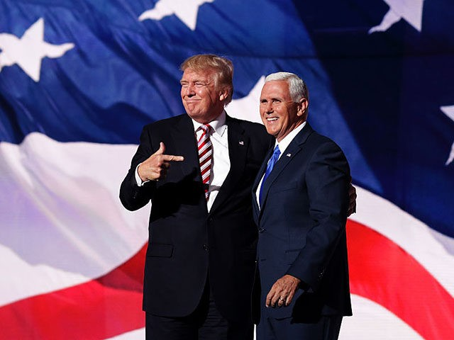CLEVELAND, OH - JULY 20: Republican presidential candidate Donald Trump stand with Republican vice presidential candidate Mike Pence and acknowledge the crowd on the third day of the Republican National Convention on July 20, 2016 at the Quicken Loans Arena in Cleveland, Ohio. Republican presidential candidate Donald Trump received the …