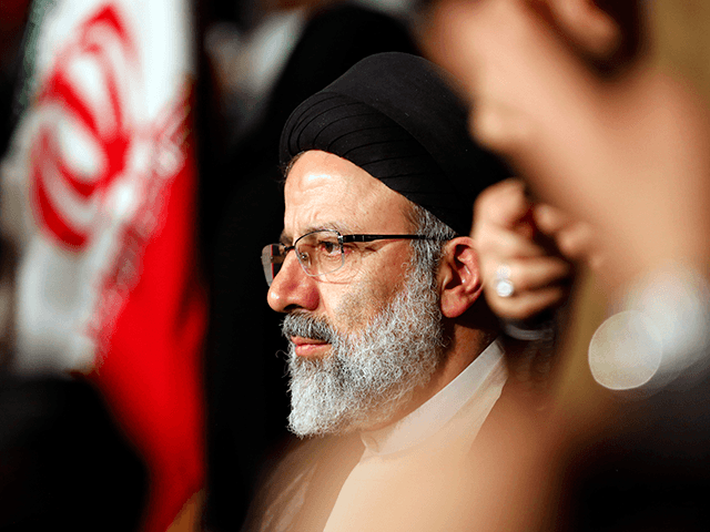 Iranian presidential candidate Ebrahim Raisi looks on during a campaign rally in the capital Tehran on April 29, 2017. / AFP PHOTO / ATTA KENARE (Photo credit should read ATTA KENARE/AFP via Getty Images)