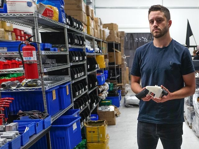 "Cody Wilson, owner of Defense Distributed company, holds a 3D printed gun, called the ""Liberator"", in his factory in Austin, Texas on August 1, 2018. (Kelly West/AFP via Getty Images)"