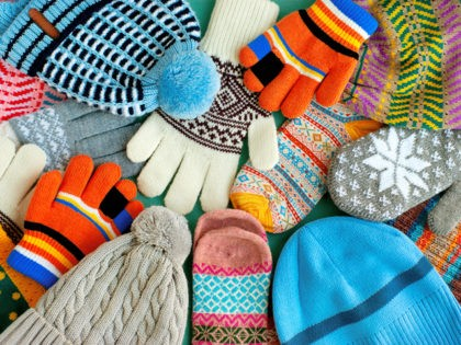 Warm clothes in the form of knitted hats, mittens, gloves, scarves for the cold seasons. Multi-colored clothes for autumn and winter.