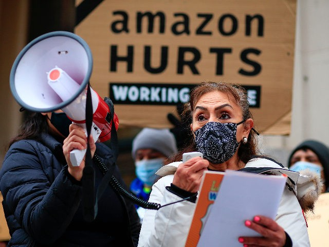 Alma Delia Garcia of New York Communities for Change speaks during a protest organized by New York Communities for Change and Make the Road New York in front of the Jeff Bezos' Manhattan residence in New York on December 02, 2020. (Photo by Kena Betancur / AFP) (Photo by KENA …