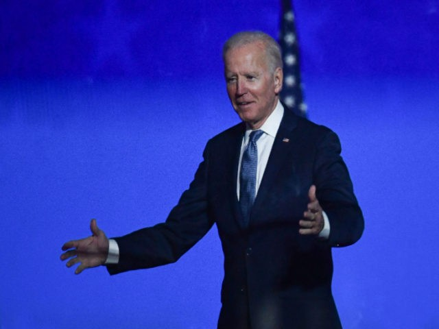 "Democratic presidential nominee Joe Biden greets supporters after speaking during election night at the Chase Center in Wilmington, Delaware, early on November 4, 2020. - Democrat Joe Biden said early Wednesday he believes he is ""on track"" to defeating US President Donald Trump, and called for Americans to have patience …"