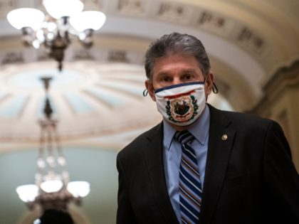 WASHINGTON, DC - FEBRUARY 11: Sen. Joe Manchin (D-WV) walks to the Senate Chamber on the third day of former President Donald Trump's second impeachment trial at the U.S. Capitol on February 11, 2021 in Washington, DC. House impeachment managers will make the case that Trump was singularly responsible for …