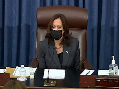 In this image from Senate TV, Vice President Kamala Harris sits in the chair on the Senate floor to cast the tie-breaking vote, her first, Friday, Feb. 5, 2021 at the Capitol in Washington. The Senate early Friday approved a budget resolution that paves the way for fast-track passage of …
