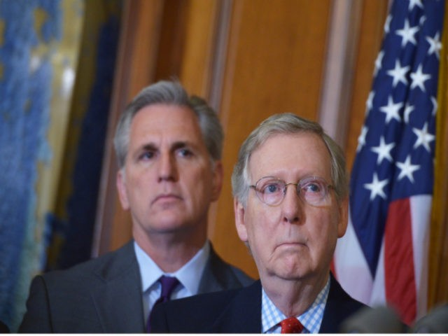 Senate Majority Leader Mitch McConnell (R), R-KY, stands next to House Majority Leader Kevin McCarthy, R-CA, during a signing ceremony for the Keystone XL Pipeline Approval Act on February 13, 2015 in the Rayburn Room of the US Capitol in Washington, DC. AFP PHOTO/MANDEL NGAN (Photo credit should read MANDEL …
