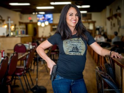 Owner Lauren Boebert poses for a portrait at Shooters Grill in Rifle, Colorado on April 24, 2018. - Lauren Boebert opened Shooters Grill in 2013 with her husband Jason in the small town of Rifle, Colorado, the only city in the United States named after a gun according to them. …