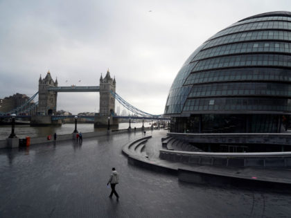 TOPSHOT - Pedestrians walk along the Thames river embankment near the Tower Bridge in central London on February 4, 2021, during the third national coronavirus lockdown. - Oxford University announced on Thursday it will launch a medical trial alternating doses of Covid-19 vaccines created by different manufacturers, the first study …