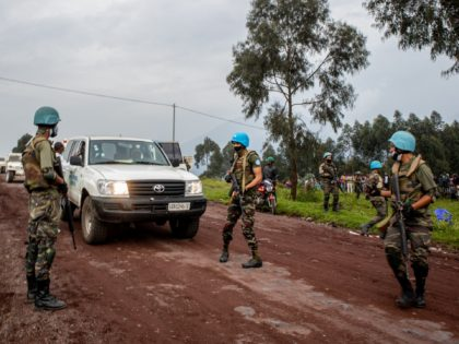 KIBUMBA, DEMOCRATIC REPUBLIC OF THE CONGO - FEBRUARY 22: UN peacekeepers and Congolese armed forces stand near an ambulance transporting a victim from the site where Italian Ambassador Luca Attanasio was fatally attacked when the convoy he was traveling in came under attack on February 22, 2021 near the village …