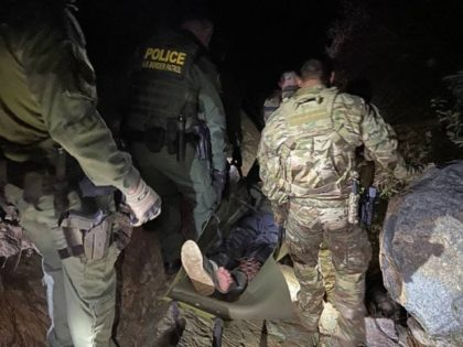 BORSTAR agents rescue a migrant abandoned on Otay Mountain after illegally entering the United States. (U.S. Border Patrol/El Centro Sector)