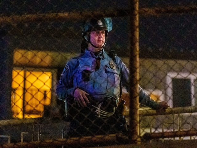 A Minneapolis Police Department officer stands in a line to control demonstrators after declaring an unlawful assembly in Minneapolis, Minnesota on November 4, 2020. - Democrats and Republicans girded November 4 for a legal showdown to decide the winner of the tight presidential race between Republican Donald Trump and Democrat …