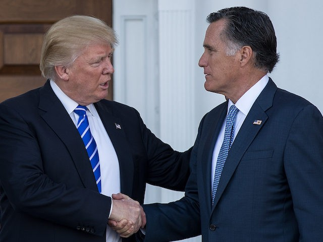 Then President-elect Donald Trump shakes hands with Senator Mitt Romney after their meeting at Trump International Golf Club, November 19, 2016 in Bedminster Township, New Jersey. (Drew Angerer/Getty Images)