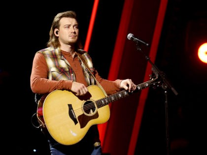 """NASHVILLE, TENNESSEE: (FOR EDITORIAL USE ONLY) Morgan Wallen performs onstage at Nashville's Music City Center for """"The 54th Annual CMA Awards"""" broadcast on Wednesday, November 11, 2020 in Nashville, Tennessee. (Photo by Terry Wyatt/Getty Images for CMA)"""