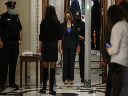Speaker of the House Nancy Pelosi (D-CA) cooperates with U.S. Capitol Police as she screened at a metal detector at the doors of the House of Representatives Chamber during a series of votes on January 12, 2021 in Washington, DC. Today the House of Representatives plans to vote on Rep. …