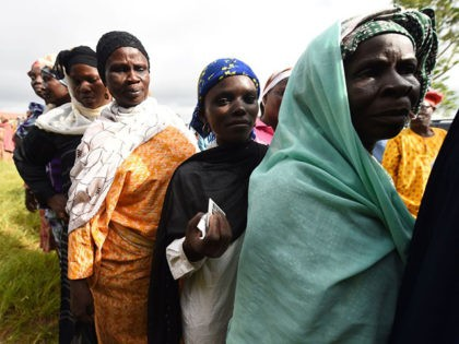 Women queue to cast their vote during the Osun State gubernatorial election in Ede, in the Osun State in southwest Nigeria, on September 22, 2018. - The Osun election is seen as a litmus test for President Mohammadu Buhari who is seeking a second term in February, 2019 election. (Photo …