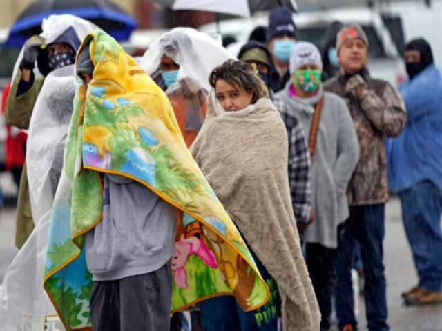 People wait in line to fill propane tanks Wednesday, Feb. 17, 2021, in Houston. Customers waited over an hour in the freezing rain to fill their tanks. (AP Photo/David J. Phillip)