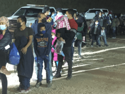 McAllen Station Border Patrol agents apprehend a large group of migrant families and unaccompanied minors near Mission, Texas. (Photo: U.S. Border Patrol/Rio Grande Valley Sector)