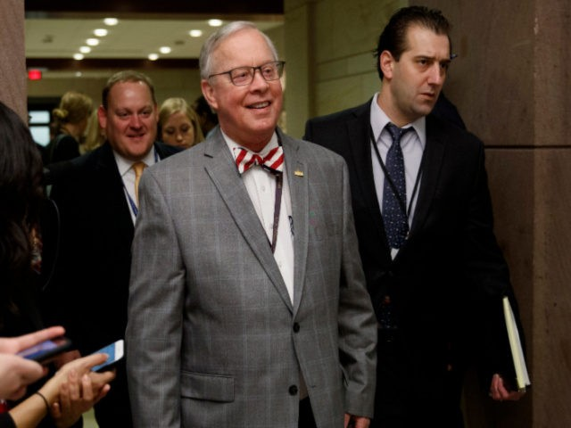 In this Nov. 15, 2018 file photo, U.S. Rep. Ron Wright, R-Texas, walks to a session during member-elect briefings and orientation on Capitol Hill in Washington. Wright, the Texas Republican who had battled health challenges over the past year including lung cancer treatment died Sunday, Feb. 7, 2021, more than …