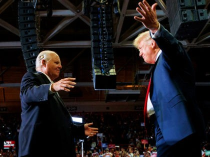 President Donald Trump opens his arms to Rush Limbaugh as he arrives to speaks during a rally at Show Me Center, Monday, Nov. 5, 2018, in Cape Girardeau, Mo.. (AP Photo/Carolyn Kaster)