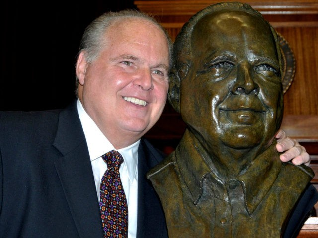 In this May 14, 2012 file photo, conservative commentator Rush Limbaugh poses with a bust in his likeness during a ceremony inducting him into the Hall of Famous Missourians in the state Capitol in Jefferson City, Mo. Limbaugh says he's been diagnosed with advanced lung cancer. Addressing listeners on his …