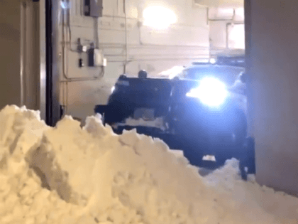 Antifa blocks a Seattle police parking garage with a snow barrier. (Twitter Video Screenshot/Katie Daviscourt)