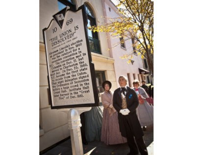 CHARLESTON, SC - DECEMBER 20: Historic re-enactors dressed in period costume stop to view the newly unveiled marker in observance of the 150th Anniversary of South Carolina's Secession from the Union on December 20, 2010 in Charleston, SC. South Carolina was the first state to secede resulting in the US …