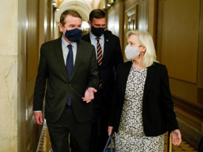 (From L) US Senators' Michael Bennet (D-CO), Martin Heinrich (D-NM) and Kirsten Gillibrand (D-NY) walk during dinner break in the second day of former US President Donald Trump's impeachment trial before the Senate on Capitol Hill February 10, 2021, in Washington, DC. - Democrats present the case against Donald Trump …