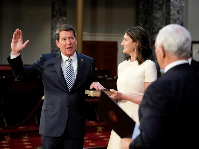WASHINGTON, DC - JANUARY 3: Sen. Bill Hagerty (R-TN) joined by his wife Chrissy Hagerty, takes the oath of office from Vice President Mike Pence during a mock swearing-in ceremony in the Old Senate Chamber at the Capitol on January 3, 2021 in Washington, DC. Both chambers are holding rare …