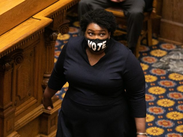 ATLANTA, GA - DECEMBER 14: Presiding officer Stacey Abrams enters the Senate chambers with other Georgia Democratic Electors to cast their Electoral College votes at the Georgia State Capitol on December 14, 2020 in Atlanta, Georgia. 16 Electoral College votes were cast for President-elect Joe Biden and Vice President-elect Kamala …