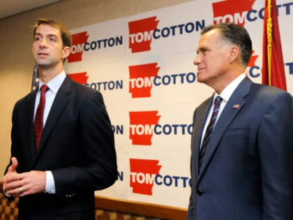 U.S. Rep. Tom Cotton, R-Ark., left, speaks at a North Little Rock, Ark., news conference as former Republican Presidential candidate Mitt Romney, right, listens Thursday, Aug. 21, 2014. Romney endorsed Cotton in the race for U.S. Senate Thursday. (AP Photo/Danny Johnston)