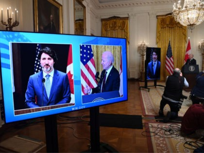 US President Joe Biden and Canadian Prime Minister Justin Trudeau (on screen) speak to the media after holding a virtual bilateral meeting in the East Room of the White House in Washington, DC, February 23, 2021. - President Joe Biden declared Canada and the United States best friends Tuesday, while …