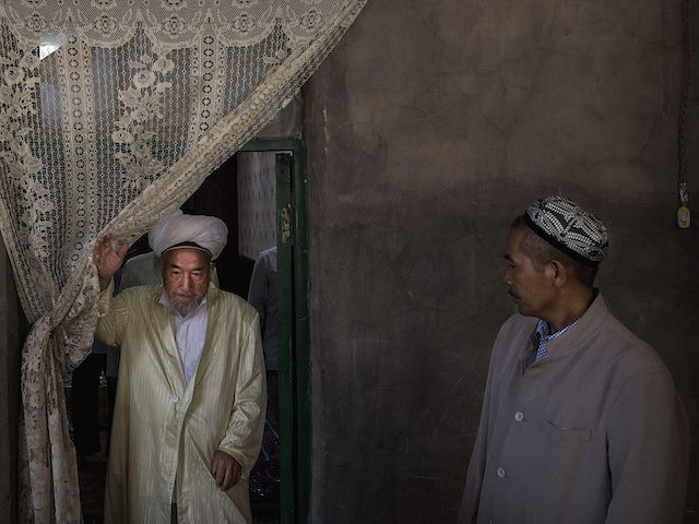In this September 2016 file photo, Uyghur men leave after eating a holiday meal during the Corban Festival on September 13, 2016 in Turpan County, in the far western Xinjiang province, China. (Kevin Frayer/Getty Images)