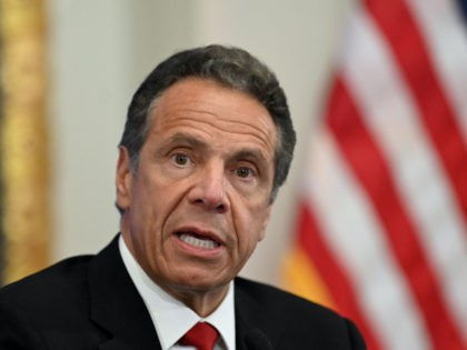 Governor of New York Andrew Cuomo speaks during a press conference at the New York Stock Exchange (NYSE) on May 26, 2020 at Wall Street in New York City. - The New York Stock Exchange, the symbolic heart of Wall Street, reopened its floor Tuesday after a two-month closure due …