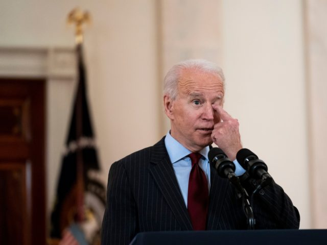 WASHINGTON, DC - FEBRUARY 22: U.S. President Joe Biden delivers remarks on the more than 500,000 lives lost to COVID-19 in the Cross Hall of the White House February 22, 2021 in Washington, DC. Also on hand for the ceremony were first lady Jill Biden, Vice President Kamala Harris and …