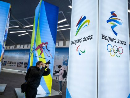 BEIJING, CHINA - FEBRUARY 05: A journalist takes pictures of a display at the exhibition center for the Beijing 2022 Winter Olympics in Yaqing district on February 5, 2021 in Beijing, China. With the one-year countdown underway, organizers of Beijings 2022 Winter Olympics say the Games will go ahead despite …