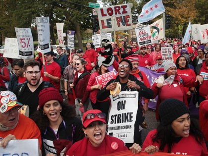 CHICAGO, ILLINOIS - OCTOBER 21: Striking Chicago public school teachers and their supporters march through the city's west side on October 21, 2019 in Chicago, Illinois. About 25,000 Chicago school teachers went on strike last week after the Chicago Teachers Union (CTU) failed to reach a contract agreement with the …
