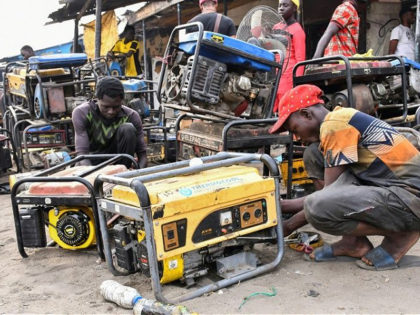 Young boys work on a generators at a workshop in the Bulabulin area of Maiduguri, on February 1, 2021. - Residents of northeast Nigerian city Maiduguri have been struggling with a power blackout for a week after jihadists blew up supply lines, causing water shortages and disrupting businesses and daily …