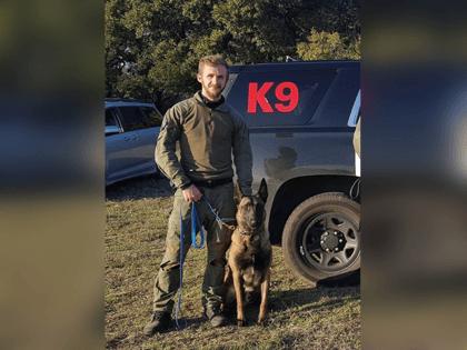 K-9 Officer Rex and his human handler Officer Sarver.