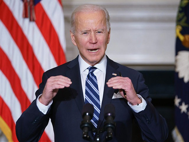 US President Joe Biden speaks on climate change, creating jobs, and restoring scientific integrity before signing executive orders in the State Dining Room of the White House in Washington, DC on January 27, 2021. (Photo by MANDEL NGAN / AFP) (Photo by MANDEL NGAN/AFP via Getty Images)
