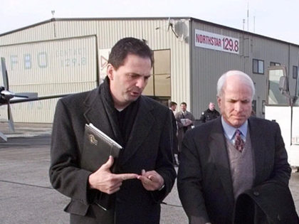 Republican presidential hopeful Sen. John McCain, of Arizona, center, walks across the tarmac at T.F. Green Airport in Warwick, R.I., with political director John Weaver, left, and political advisor Mike Murphy Tuesday afternoon, Jan. 18, 2000. Unlike every other presidential candidate, McCain has foregone Iowa for the states where he …