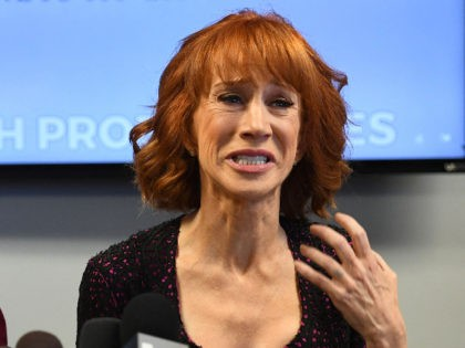 """Comedian Kathy Griffin (R) reacts during a news conference to discuss the comedian's """"motivation"""" behind a photo of her holding what appeared to be a prop depicting US President Donald Trump's bloodied, severed head, with her attorney, Lisa Bloom in Woodland Hills, California on June 2, 2017. / AFP PHOTO …"""