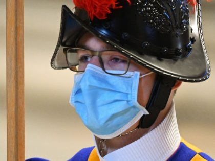 A Swiss Guard wears a surgical face mask during a Pope's Holy Mass as part of World Youth Day on November 22, 2020 at St. Peter's Basilica in The Vatican. (Photo by Vincenzo PINTO / POOL / AFP) (Photo by VINCENZO PINTO/POOL/AFP via Getty Images)
