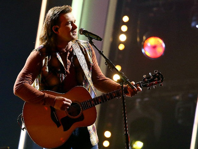 """NASHVILLE, TENNESSEE : (FOR EDITORIAL USE ONLY) Morgan Wallen performs onstage at Nashville's Music City Center for """"The 54th Annual CMA Awards"""" broadcast on Wednesday, November 11, 2020 in Nashville, Tennessee. (Photo by Terry Wyatt/Getty Images for CMA)"""