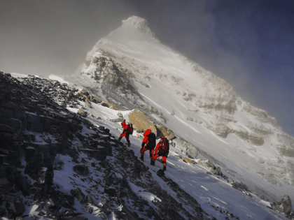 In this May 27, 2020, file photo released by Xinhua News Agency, members of a Chinese surveying team head for the summit of Mount Everest, also known locally as Mt. Qomolangma. China and Nepal have jointly announced on Tuesday, Dec. 8, 2020, a new height for Mount Everest, ending a …
