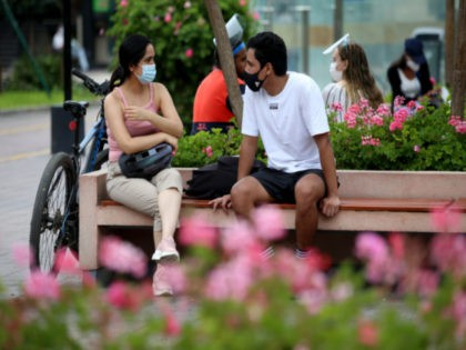 A couple wearing face masks talks on the bench in a park of Miraflores ahead of Lima's total lockdown to stop surge of coronavirus cases on January 30, 2021 in Lima, Peru. President Francisco Sagasti ordered total lockdown in Lima and nine other regions from January 31 to February 14 …