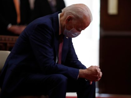 "FILE - In this June 1, 2020, file photo, Democratic presidential candidate, former Vice President Joe Biden bows his head in prayer as he visits Bethel AME Church in Wilmington, Del. Photos in a campaign ad for President Donald Trump show that former Vice President Biden is ""alone, hiding, diminished."" …"
