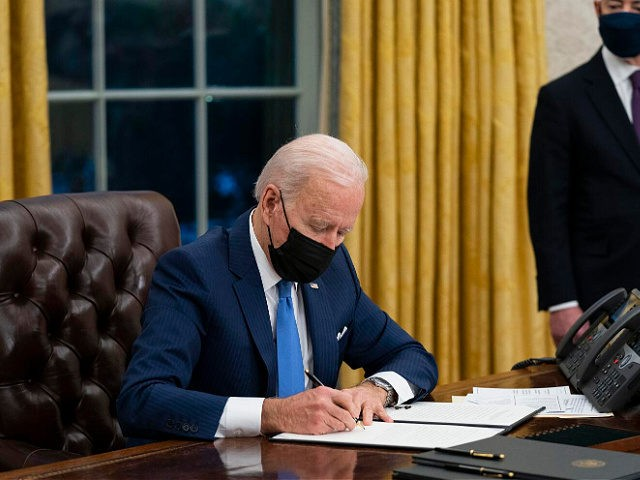 FILE - In this Tuesday, Feb. 2, 2021, file photo, Secretary of Homeland Security Alejandro Mayorkas looks on as President Joe Biden signs an executive order on immigration, in the Oval Office of the White House in Washington. Faith-based organizations involved in refugee resettlement are celebrating President Joe Biden's new …