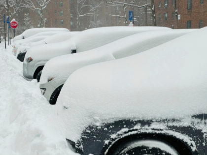 A major Nor'Easter hits New York City. Snowfall totals of 18 inches or more are expected. People enjoyed the snowy weather while the Department of Sanitation cleared city streets.