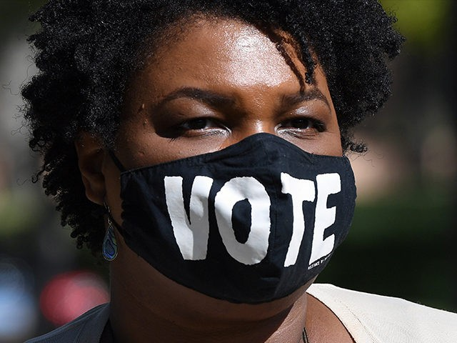 LAS VEGAS, NEVADA - OCTOBER 24: Former Georgia gubernatorial candidate Stacey Abrams waits to speak at a Democratic canvass kickoff as she campaigns for Joe Biden and Kamala Harris at Bruce Trent Park on October 24, 2020 in Las Vegas, Nevada. In-person early voting for the general election in the …