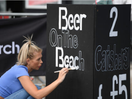 BRIGHTON, ENGLAND - MAY 16: A seafront nightclub opens to sell beer on Brighton beach on May 16, 2020 in Brighton, England. The prime minister announced the general contours of a phased exit from the current lockdown, adopted nearly two months ago in an effort curb the spread of Covid-19. …